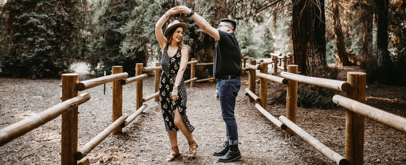 A young couple dances in a natural setting