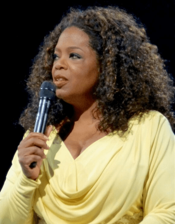 Oprah holding a microphone speaking about social anxiety