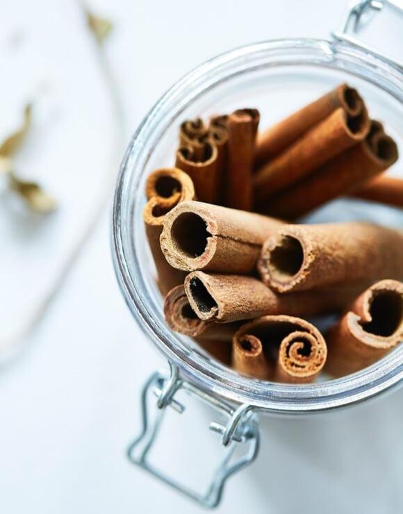 A glass jar filled with cinnamon bark