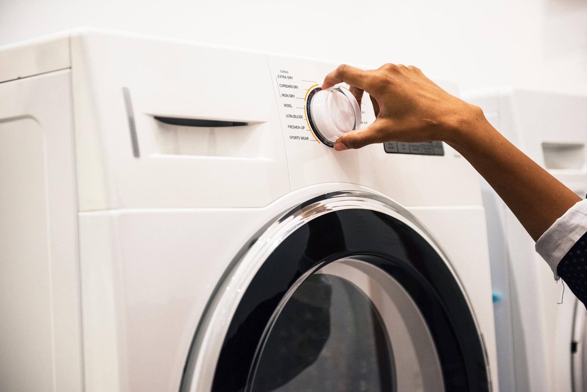 Woman using epsom salt to clean her washing machine