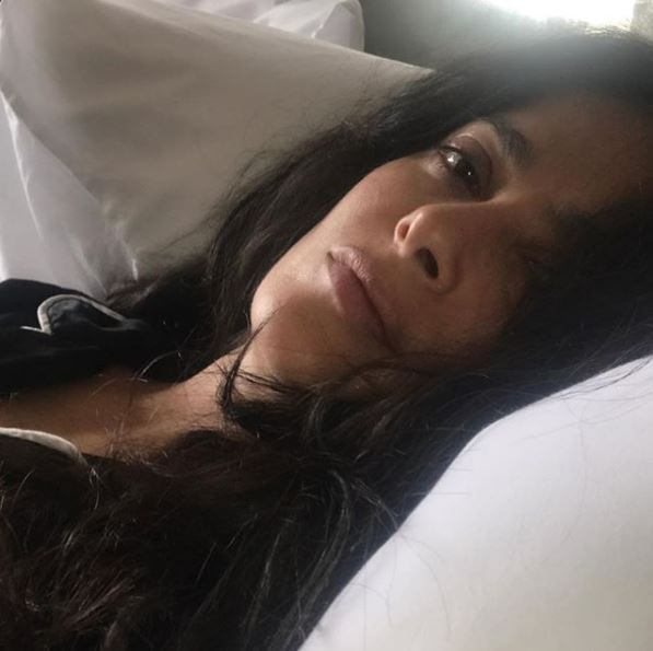 Salma Hayek poses for the camera with a refreshing no makeup look