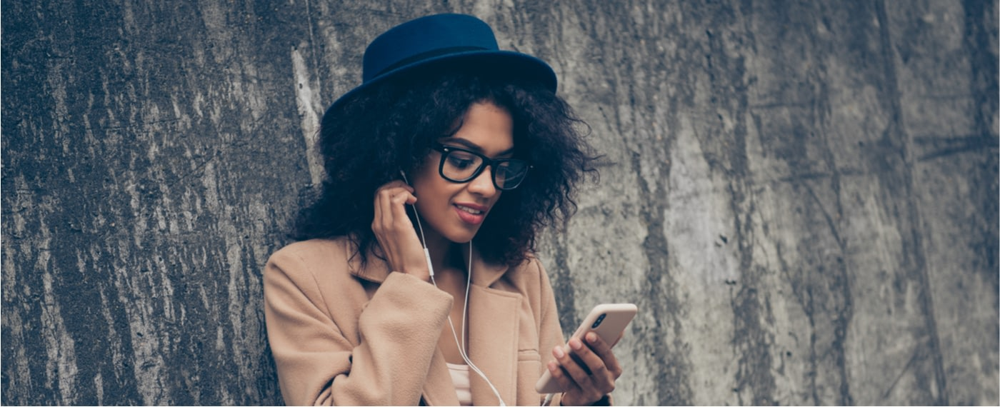 Stylish girl using headphones to listen to self-talk app