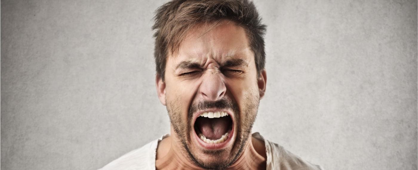 An enraged man loses his temper