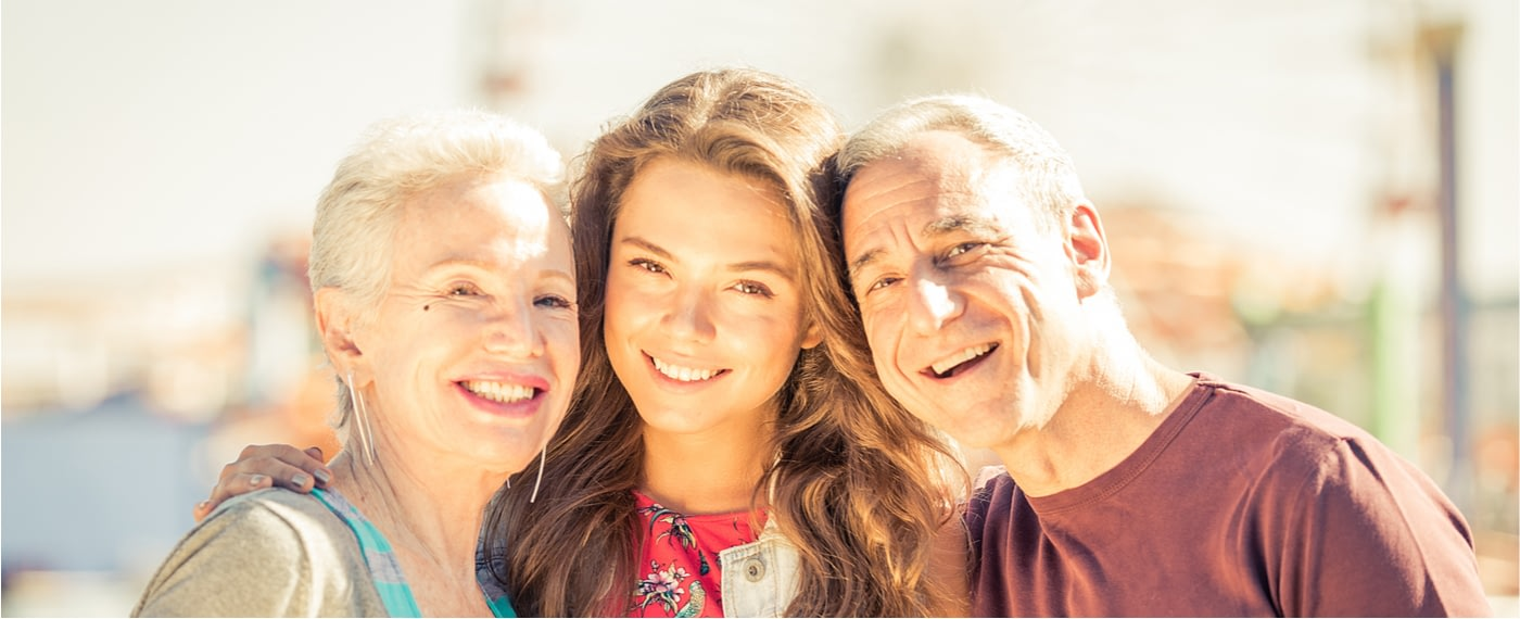 A young woman enjoying a healthy relationship with her parents