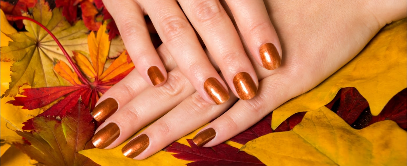 woman showing off trendy fall nail manicure