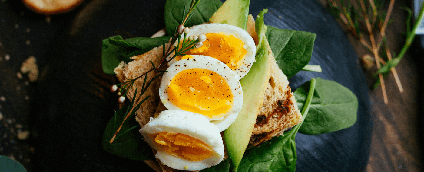 Boiled eggs over toast and spinach