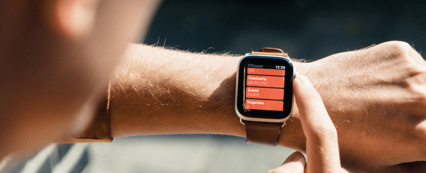 Orange smart watch with fitness tracker screen