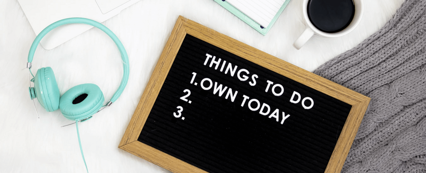 "Mini cork board that says ""own today"" on table"