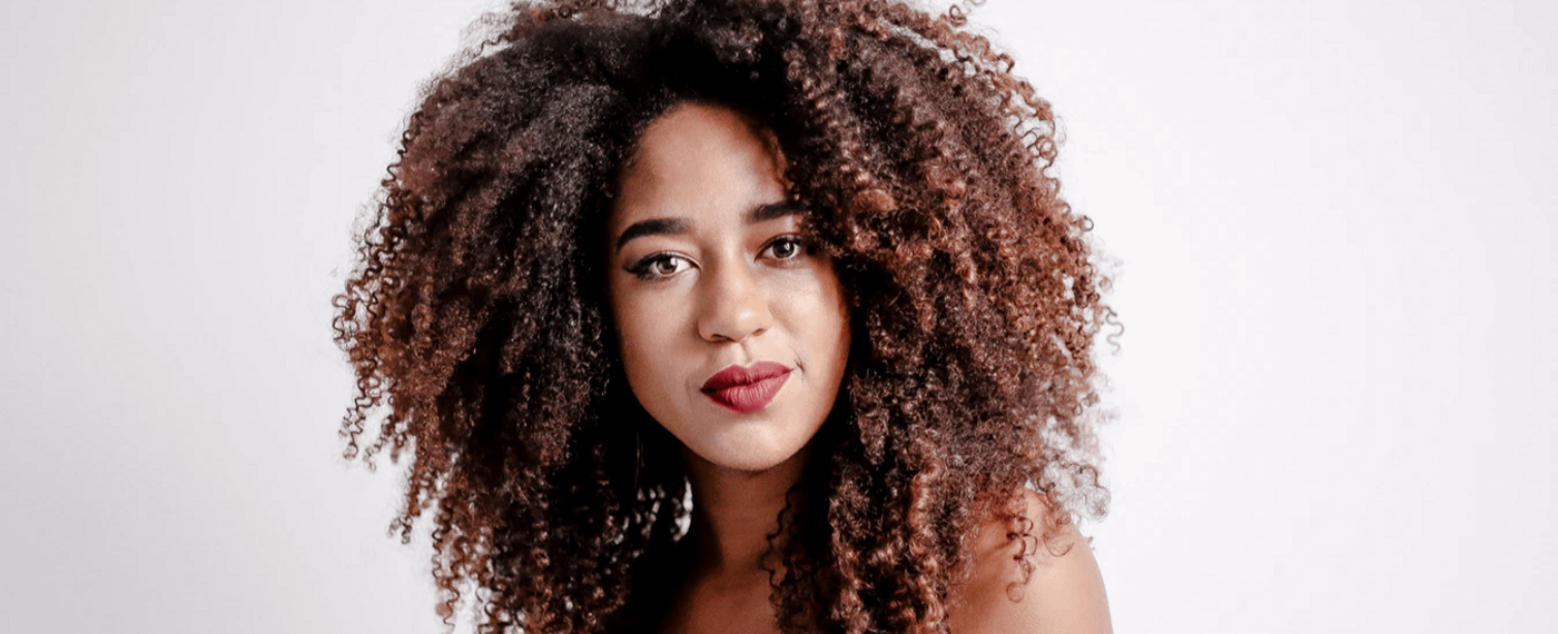 Woman with curly hair against white background