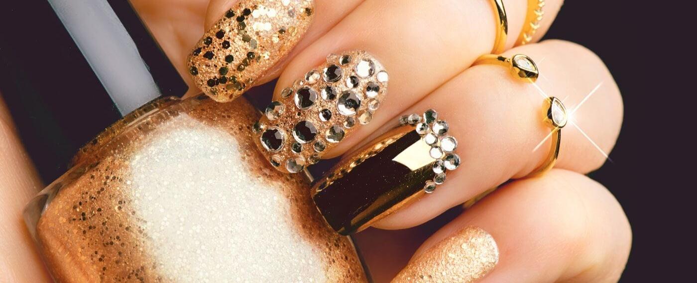 Close up of glamorous gold manicure and nail polish