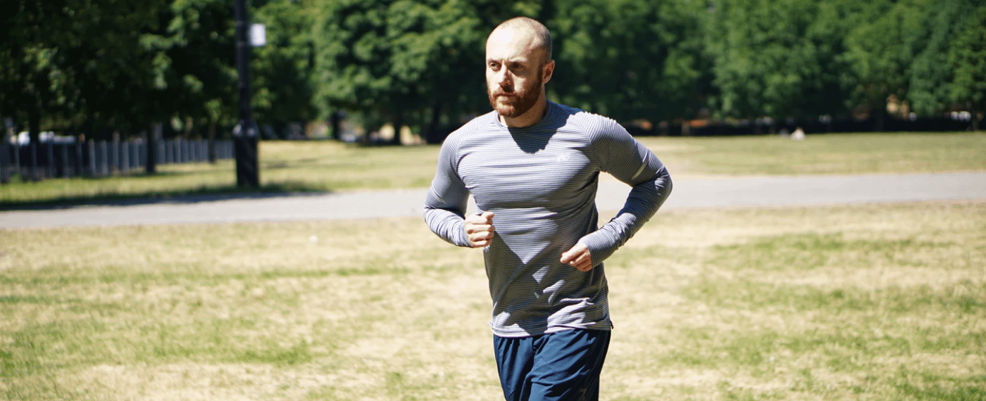 Athletic male running outdoors in the sun