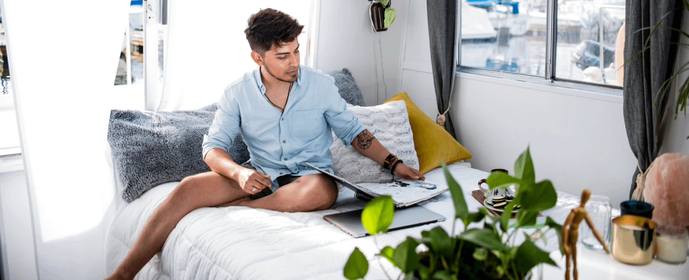 young man practicing self care while working from home