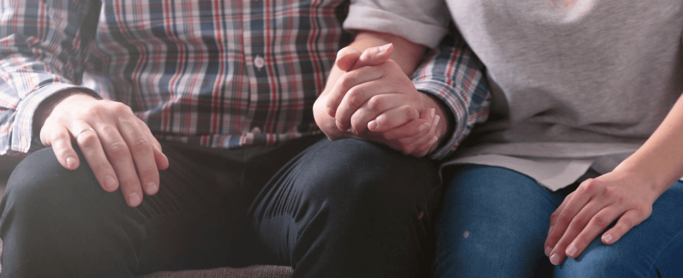 Woman and man holding hands before speaking about sexual needs