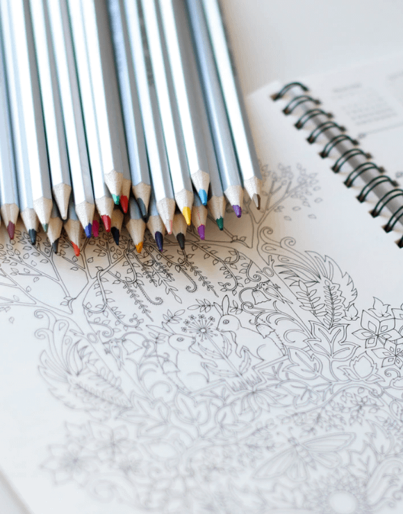 An assortment of colored pencils to color a detailed illustration