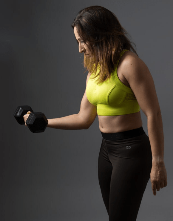 Fit female holding a dumbbell in one arms