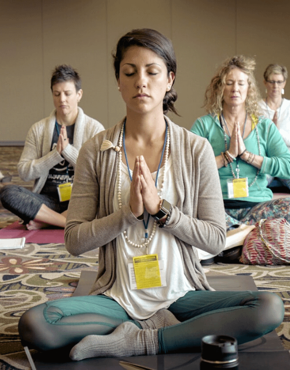 Group of women using yoga to exercise through injuries
