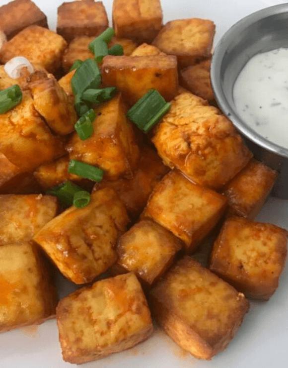 Vegan buffalo tofu pieces made in an air fryer