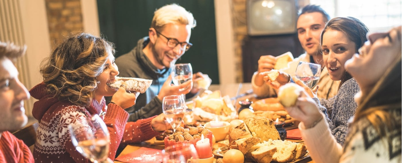Family enjoying food and wine to ease stress