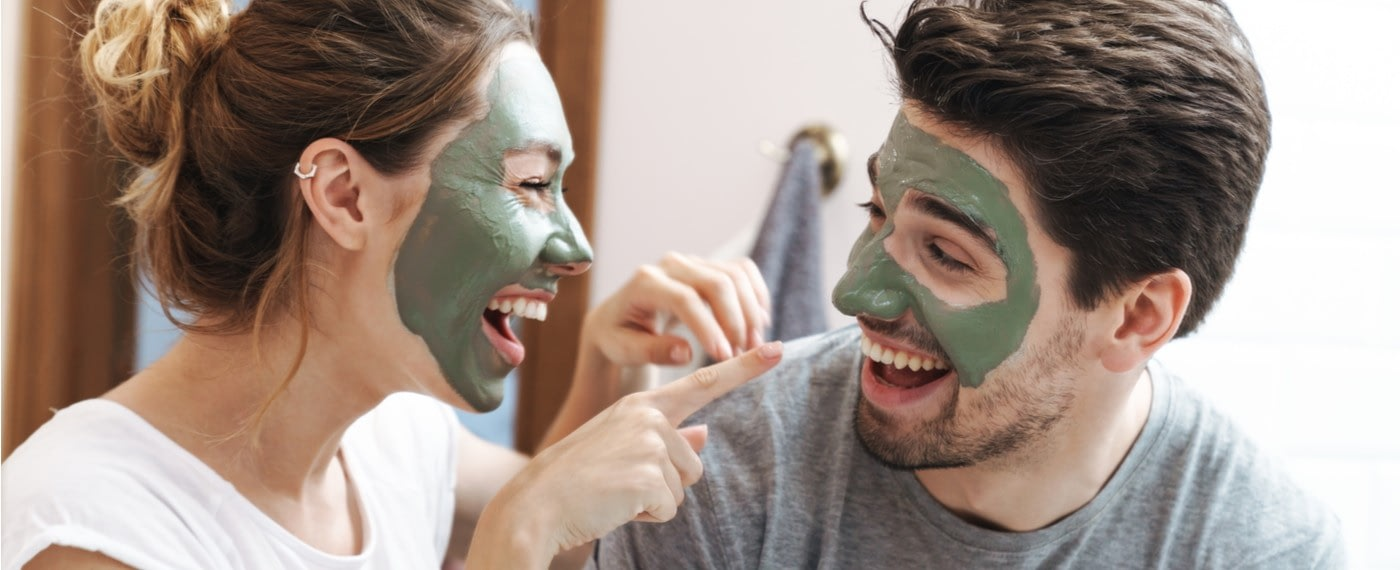 man and woman with skin care masks on