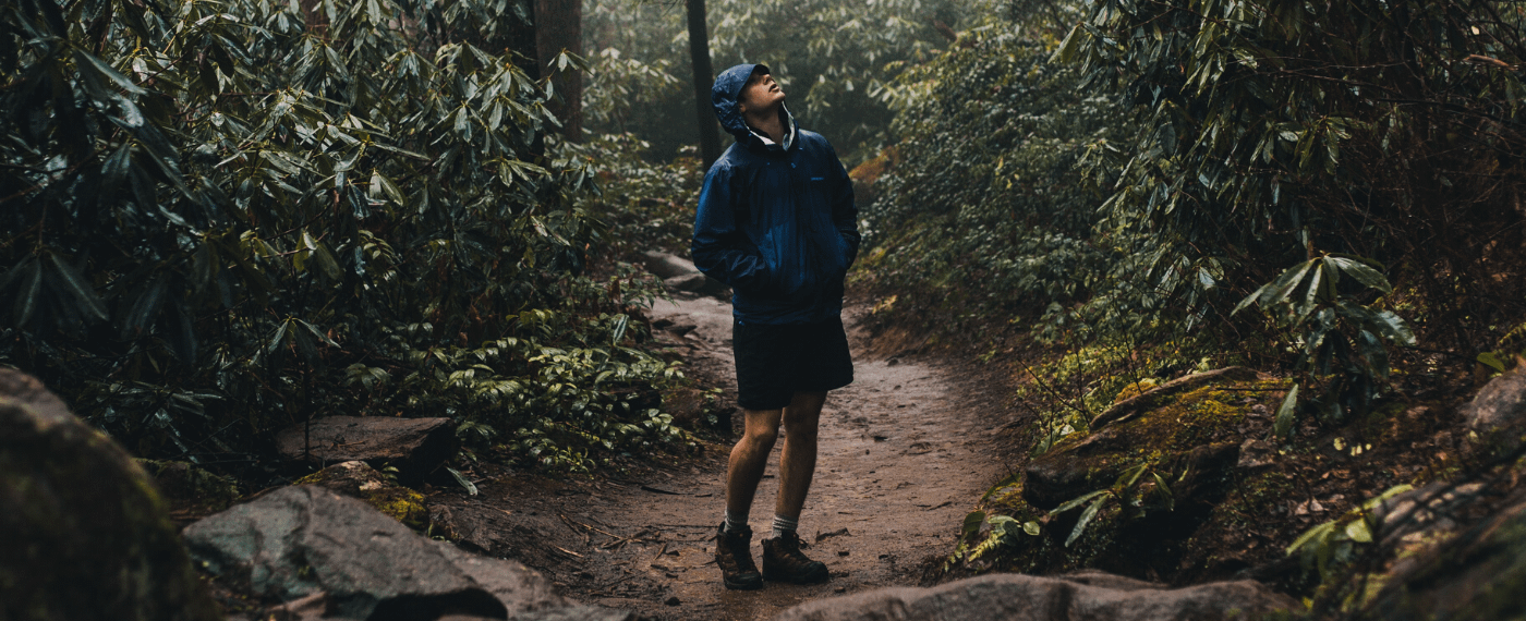 man hiking through rain-forest for fresh air