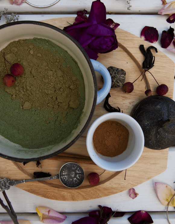 Containers of henna powder used for dying hair