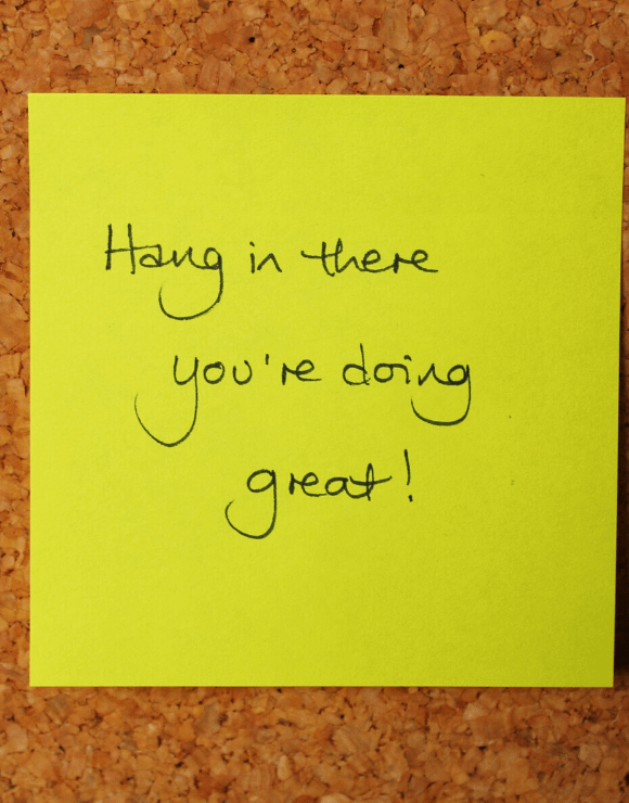 A post-it note with the phrase