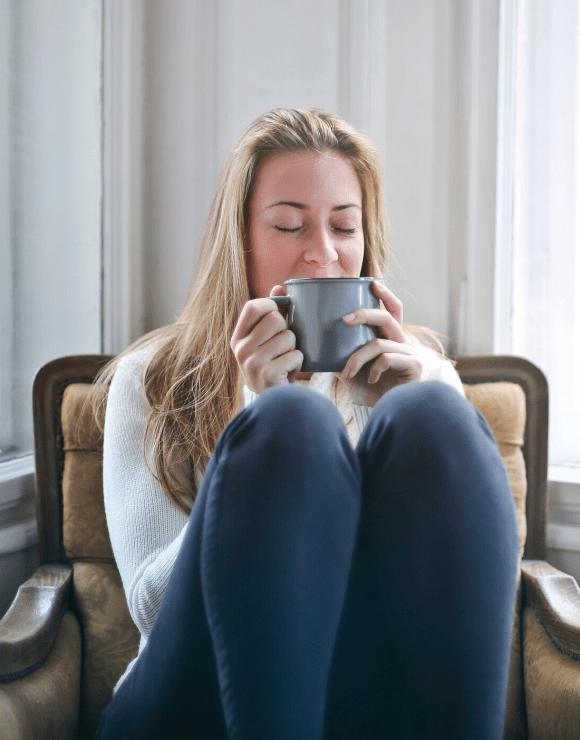 New mother unwinds from stressful day with hot cup of tea