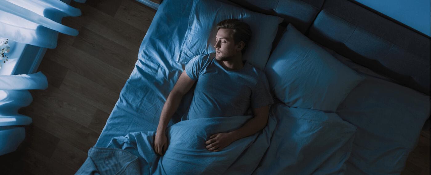 man practicing moon breathing to help sleep