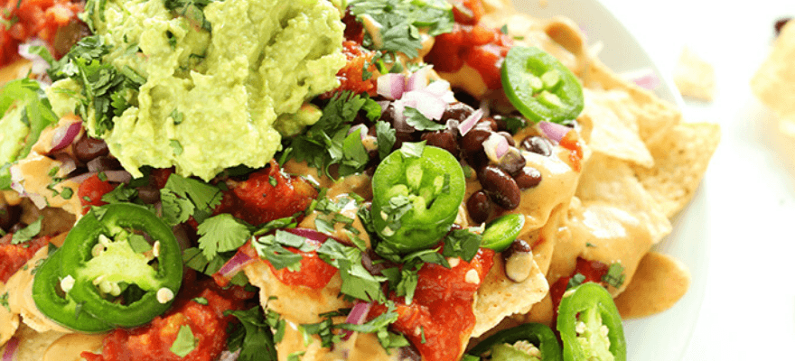 A plate of healthy loaded veggie nachos