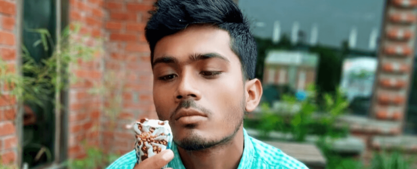 Man looks depressed at ice cream cone