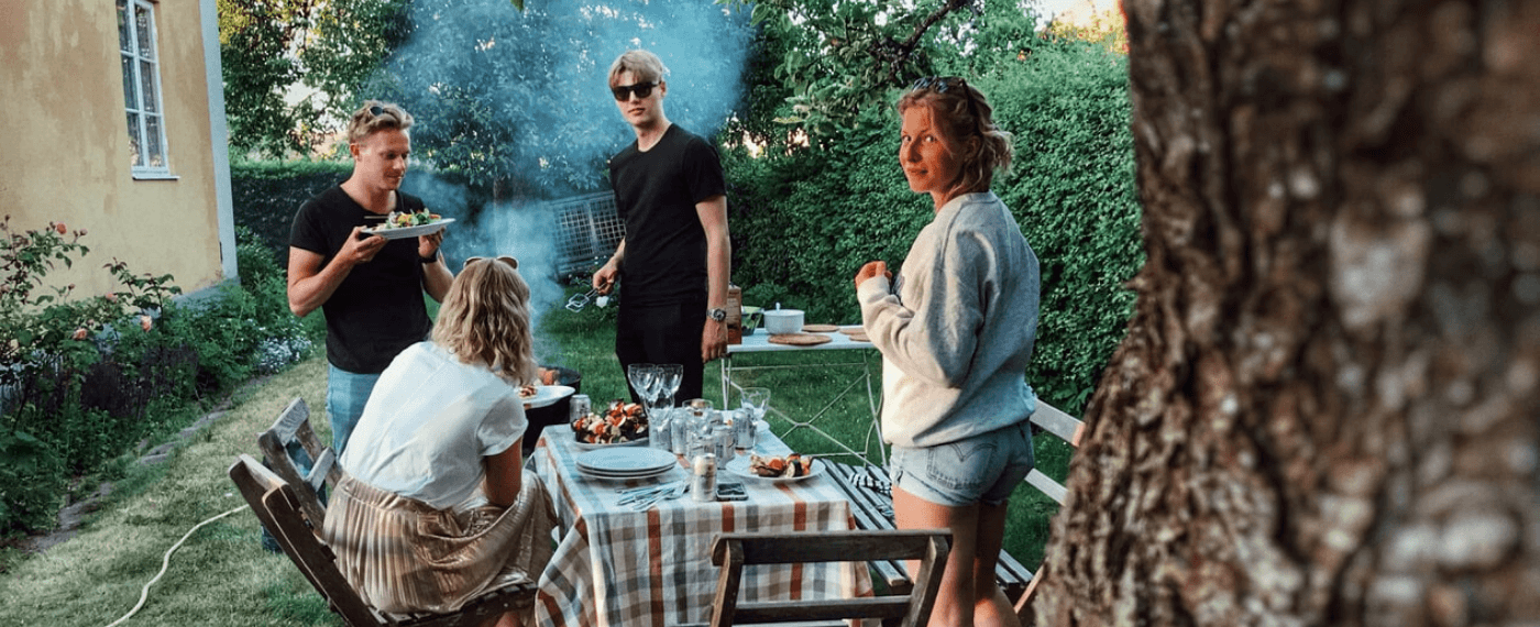Family of four barbecuing healthy options from Trader Joe's for dinner outdoors