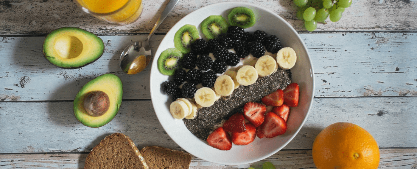 a large bowl of freshly cut fruit and chia seeds