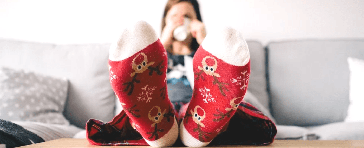 woman relaxing while wearing holiday socks