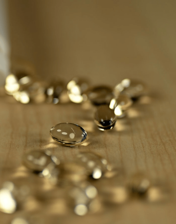 vitamin D capsules scattered on a counter-top