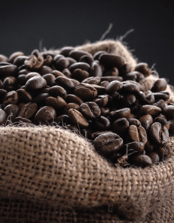 A burlap sack of raw coffee beans