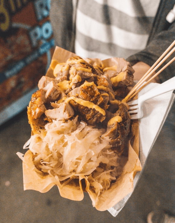 Fermented sauerkraut on top of cut up sausages with mustard