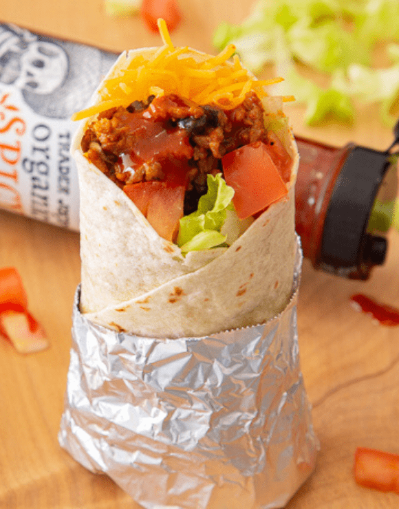 Trader Joe's Organic Spicy Taco Sauce on top of a beef and bean burrito