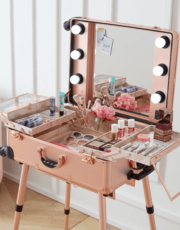 A foldout makeup trunk and vanity mirror combination