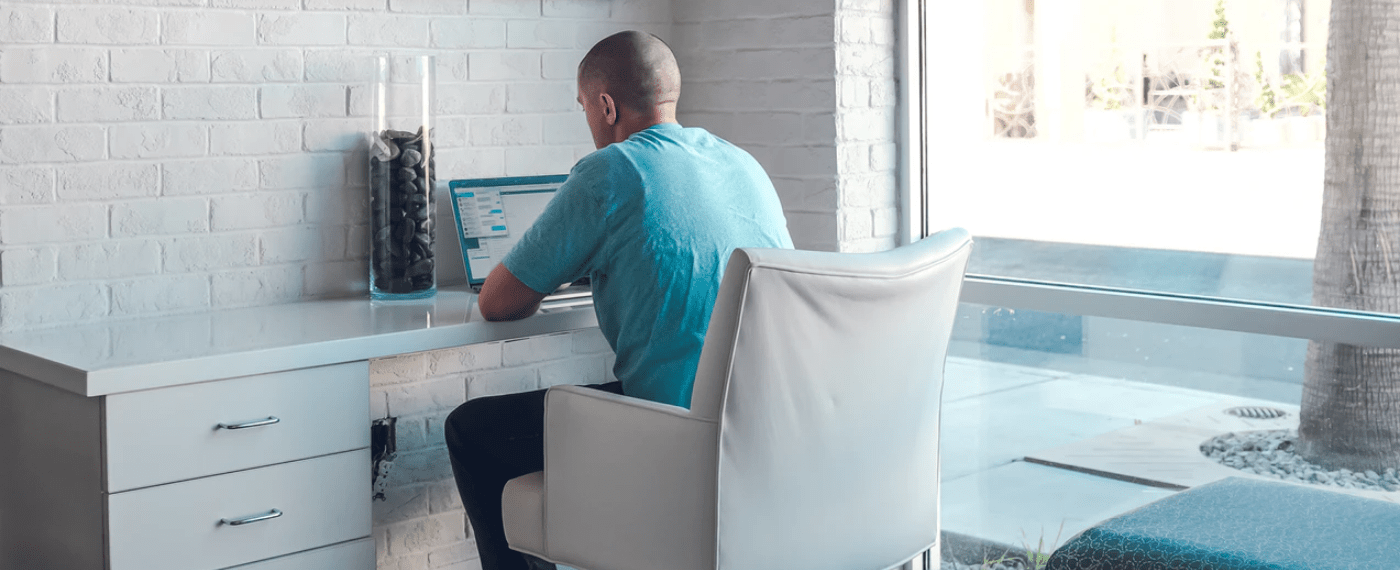 A man working from home office on laptop