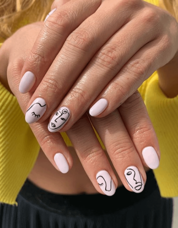 intricate art-pop pieces painted onto manicures