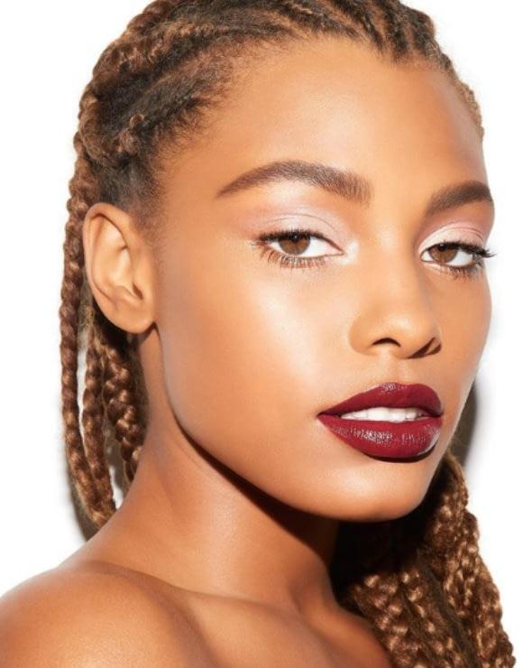 female model shows off trendy burgundy lipstick