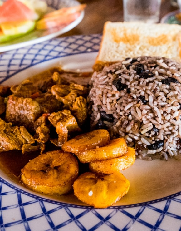Costa Rican Gallo Pinto with fried plantains, rice and beans, and pork or chicken