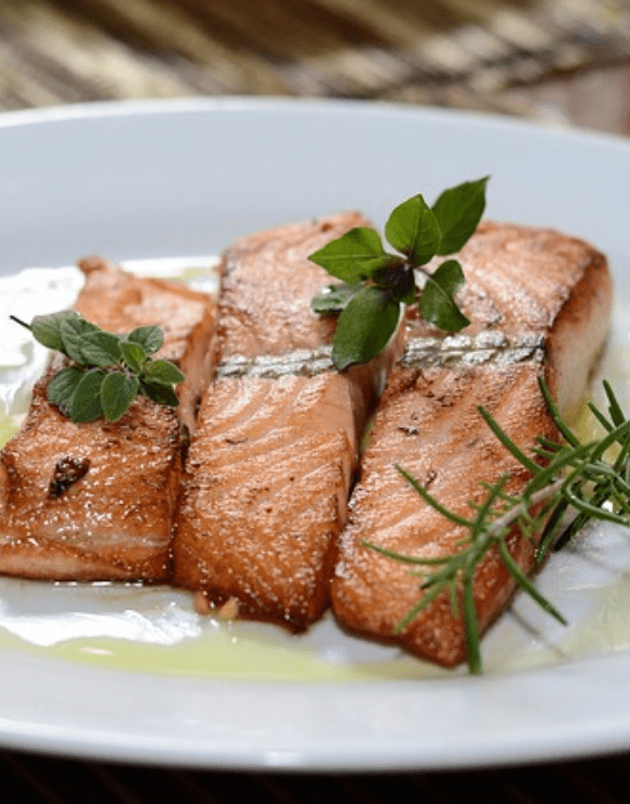 pieces of seared salmon on a plate that aid in respiratory health