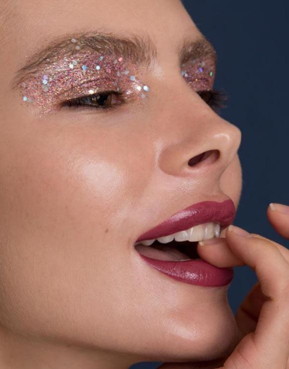girl with glitter eyebrow makeup