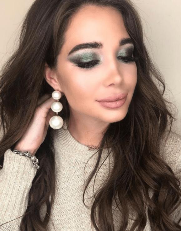 woman modeling green smokey eye makeup
