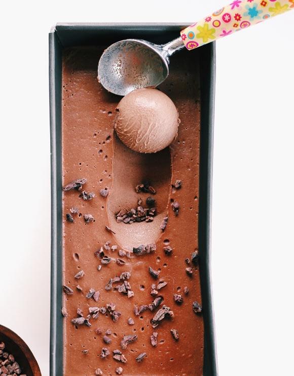 Hazelnut dark chocolate ice cream with a scoop taken out