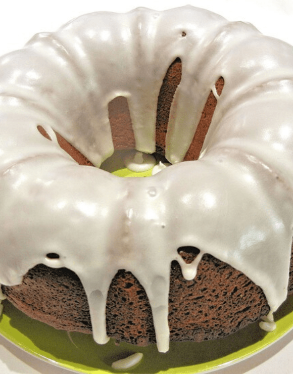 Whole grain Apple Spice Bundt Cake glazed with vanilla icing