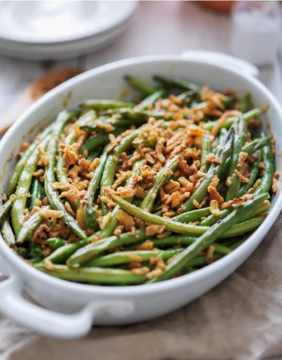 Healthy green bean casserole baked in a glass dish