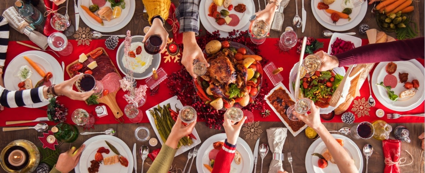 Large dinner table with a variety of holiday recipes