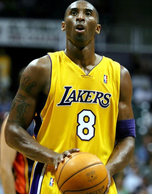 NBA Star Kobe Bryant preparing to shoot a basket